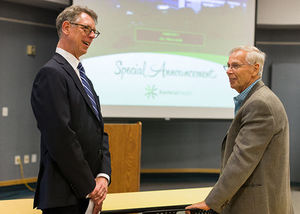 David Hayes, medical director for Mayo Clinic Care Network, and Paul Anderson, chairman of the board of the Kootenai Hospital District, mingle following a presentation to announce Kootenai Health as a member of the Mayo Clinic Care Network Tuesday at the Kootenai Health Resource Center in Coeur d���Alene. The hospital is the first in the state and 30th overall to be added to the network since 2011.